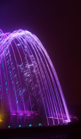 Colored water fountain at night Stock Photo - 7988273