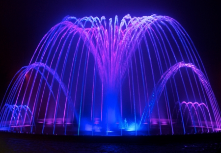 beauty fountain: Colored water fountain at night Stock Photo