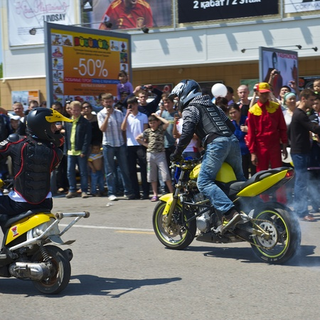 Almaty - MAY 1: Show sports bikers in honor of May, 1st on the area before a supermarket on May 1, 2011 in Almaty, Kazakhstan. Stock Photo - 9541836