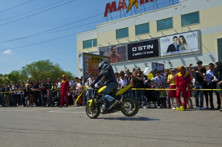 Almaty - MAY 1: Show sports bikers in honor of May, 1st on the area before a supermarket on May 1, 2011 in Almaty, Kazakhstan. Stock Photo - 9556253