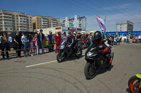 Almaty - MAY 1: Show sports bikers in honor of May, 1st on the area before a supermarket on May 1, 2011 in Almaty, Kazakhstan. Stock Photo - 9556271