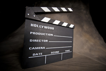 directors: A movie production clapstick board.