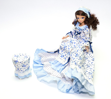 playthings: Collection doll in a blue dress
