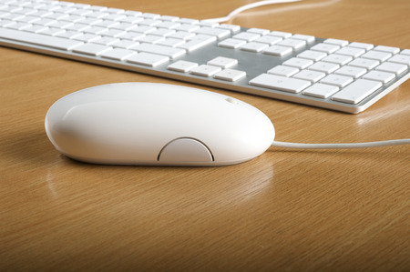 put the key: Modern aluminum computer keyboards and mouse for computer Stock Photo