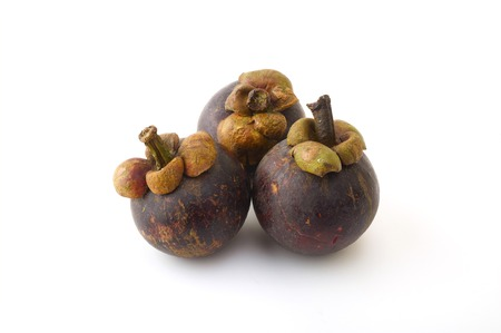 malaysia culture: Ripe mangosteen from Thailand on a white background