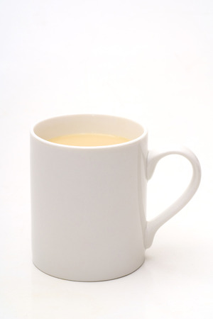 stimulating: White cup with the tea with the milk