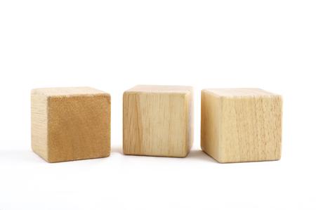 Wooden toy blocks on white background Standard-Bild