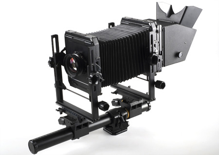 Large format camera front taken from the side.