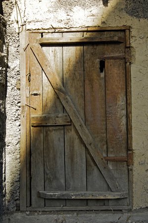 austere: Old shed with the wooden door