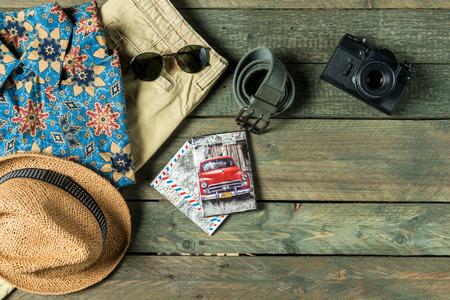 other keywords: Mock up of summer traveling stuff on wooden board.