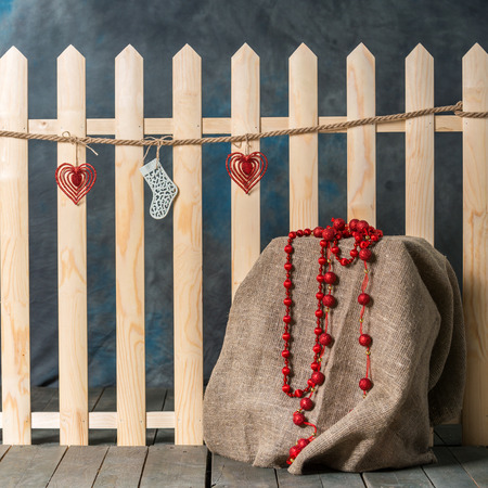 beautiful christmas toy on a wooden fence decorations for the new year stock photo - Christmas Fence Decorations