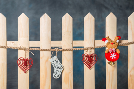 beautiful christmas toy on a wooden fence decorations for the new year stock photo