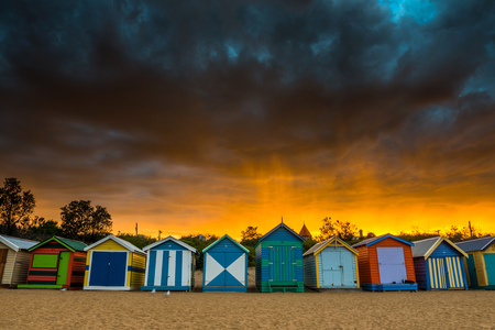 brighton: Brighton Beach, Australia: April 1, 2014: Colorful Beach House at sunrise in Brighton Beach Melbourne on April 1, 2014, Melbourne, Australia Editorial