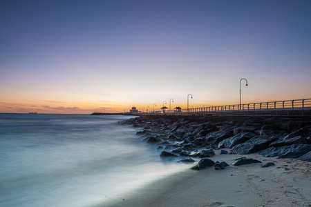 ocean waves: A sunset on St Kilda Pier in Melbourne, Australia.