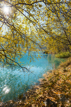 Autumn photo after snowfall, mountain lake Issyk in Almaty region, Kazakhstan. October.