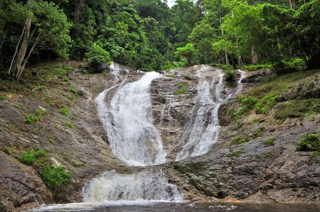 Massive Waterfall in tropical forest photo
