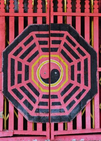 Ying yang symbol of harmony and balance on wooden door photo
