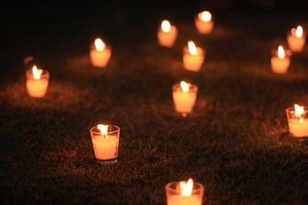 Candles in the grass at a park
