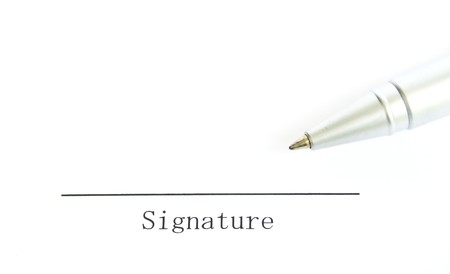 signature and pen on white paper photo