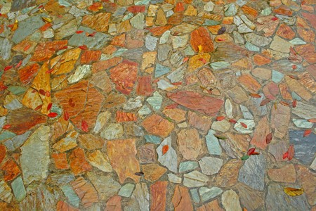Stone tiles floor with background photo