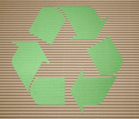 green recycling on corrugated cardboard with background photo