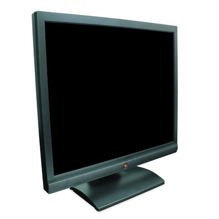 Computer monitor in black over a black background photo