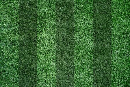 背景の人工芝生のサッカー場 写真素材