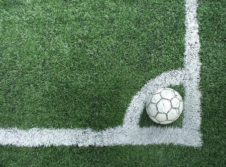 Artificial grass soccer field and old football Stock Photo - 8561821