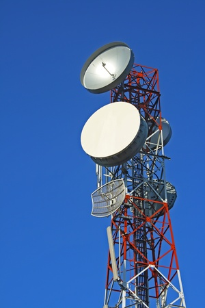 Communication tower over a blue sky Stock Photo - 8662611