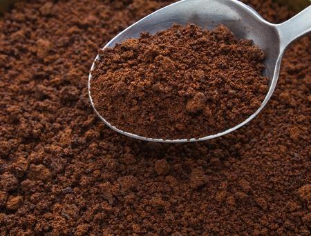 コーヒー バック グラウンドでコーヒー スプーン