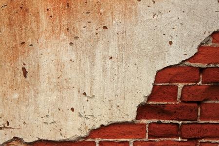 背景ひび割れコンクリートのレンガの壁