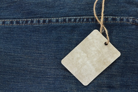 Price tag over jeans background photo