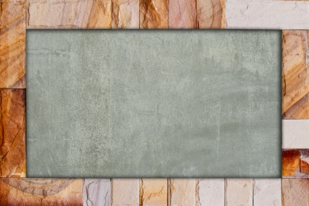 Stone brick frame with cement background photo
