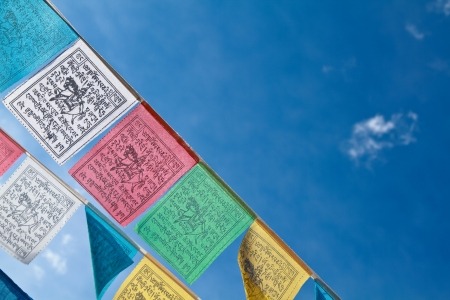 Buddhist tibetan prayer flags flying with blue sky Stock Photo - 14396982