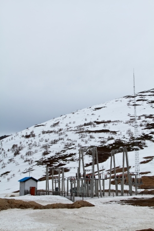 Power plant station in mountain with snow photo