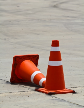 Background with traffic cone on road track photo