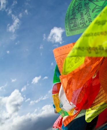 Buddhist tibetan prayer flags flying with blue sky Stock Photo - 18624053