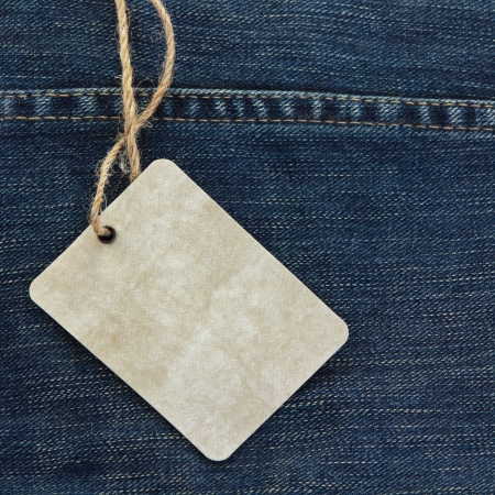 blue jeans: Price tag over jeans background Stock Photo