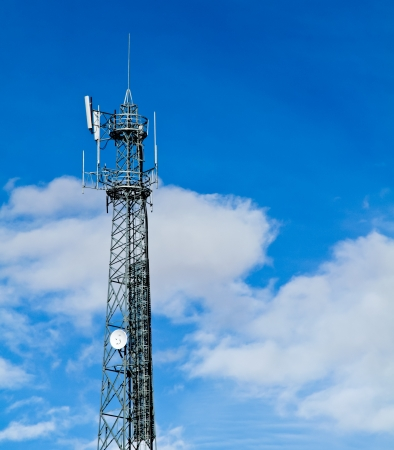 Communication tower over a blue sky background photo