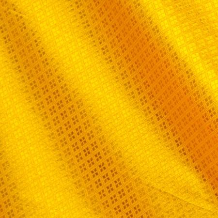 タイシルクの背景にゴールド色 写真素材