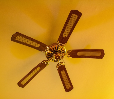 Ceiling fan hanging from a vaulted ceiling photo