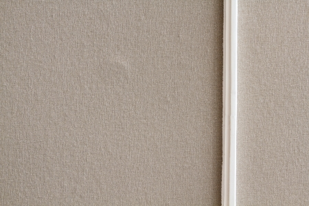 Beige wall and clean white wood board photo