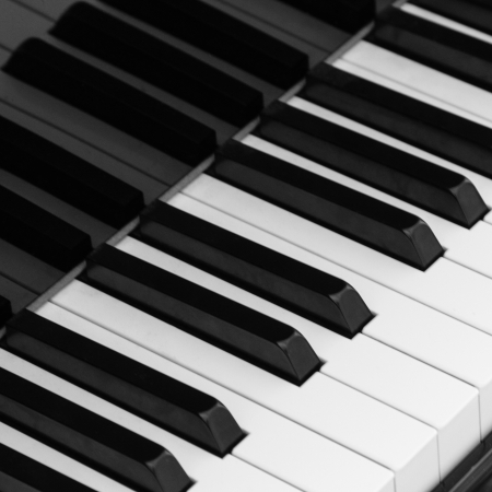 Closeup of piano key in black and white photo