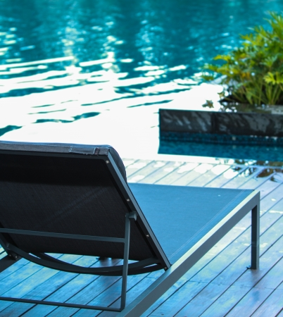 Closeup chaise lounge with swimming pool