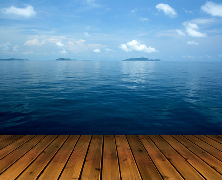Ocean with sky and wood floor  photo