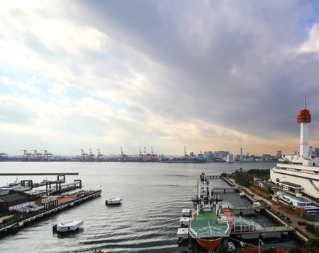 commercial docks: Commercial docks with a ship and cranes