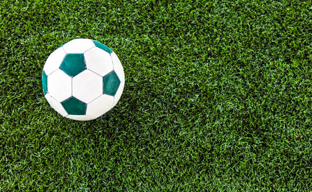 Green artificial grass soccer field for background