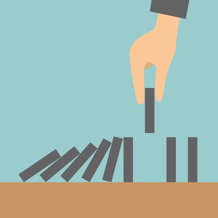 Concept zakenman de hand stoppen van het domino-effect