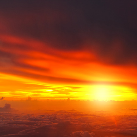 Sunset with clouds over view from airplane flying photo