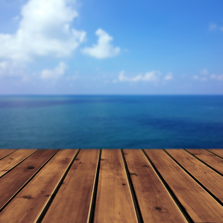Ocean with sky and wood floor for background photo